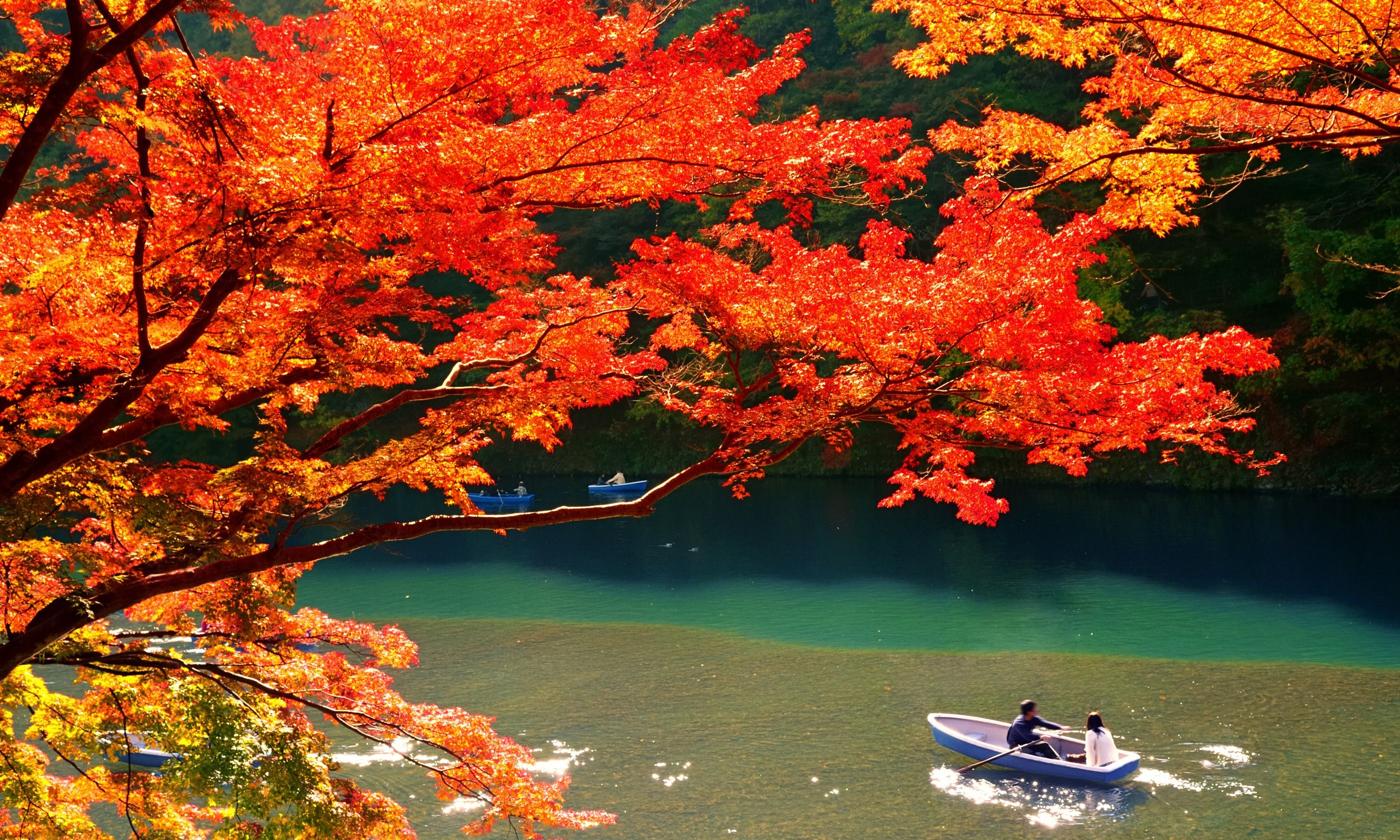 Boaters on lake in Kyoto in Autumn (Dreamstime)