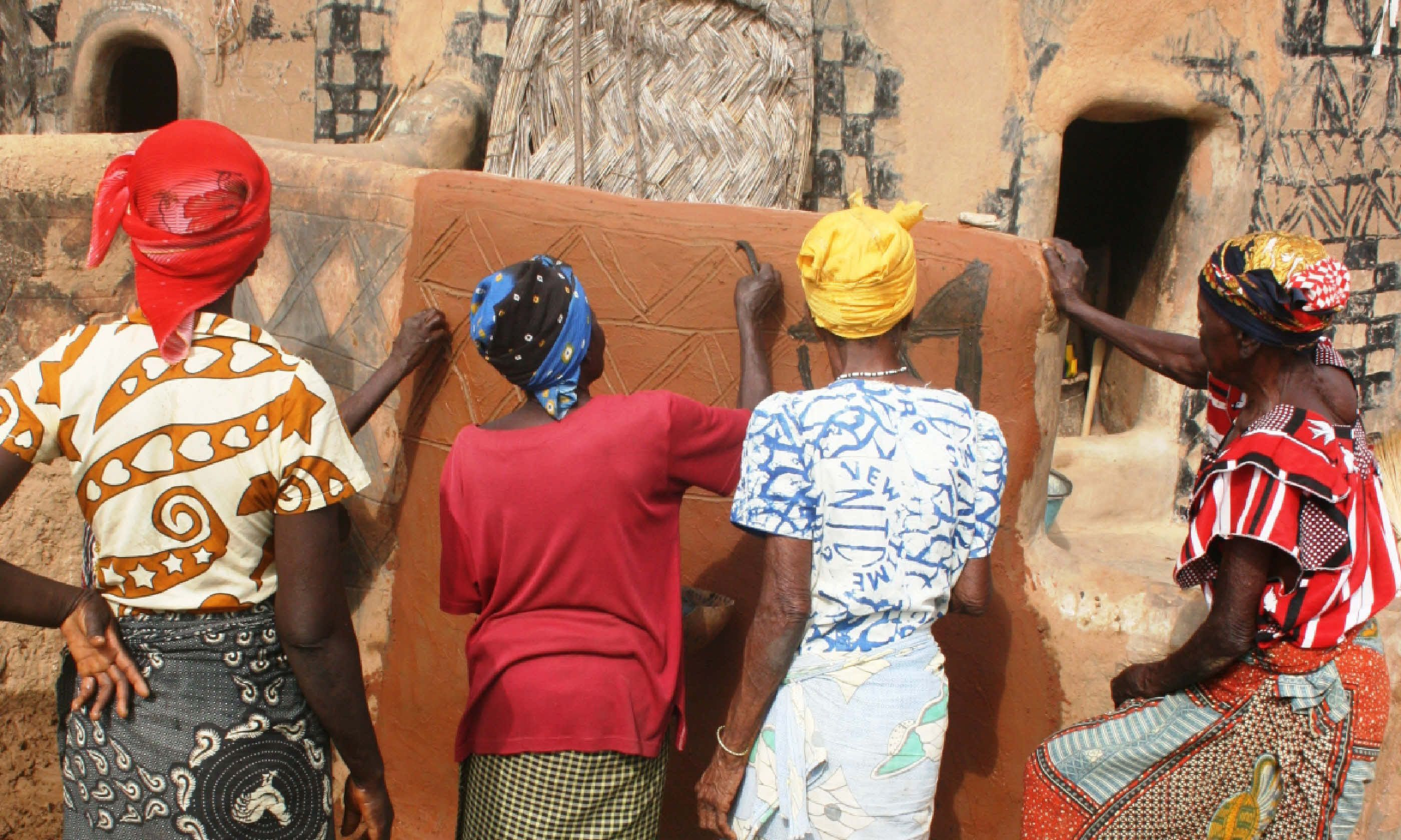 Village women paint voodoo symbols on the walls of their village (Shutterstock)