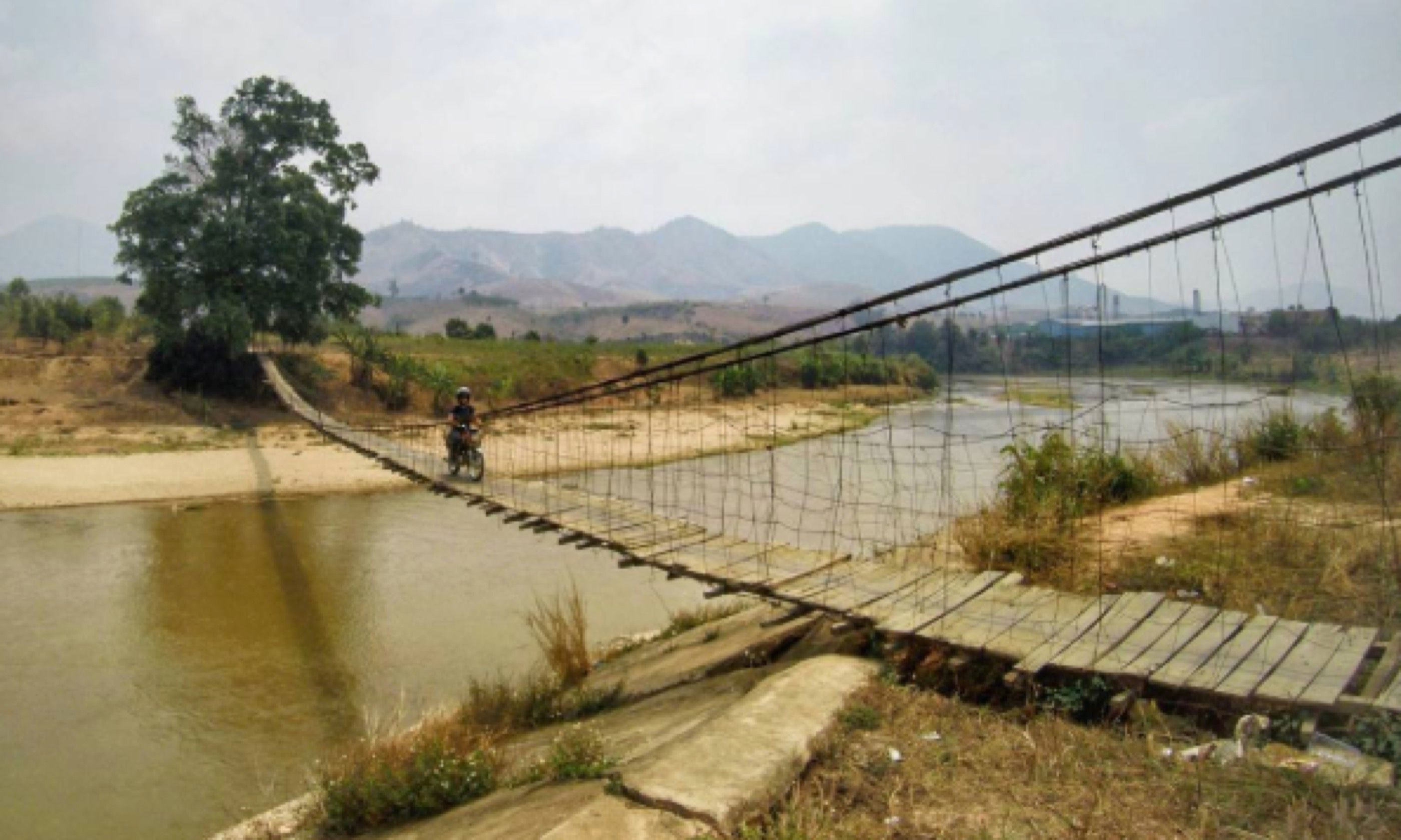 Rope bridge in northern Vietnam You will get muddy! (Jacob Laukaitis)