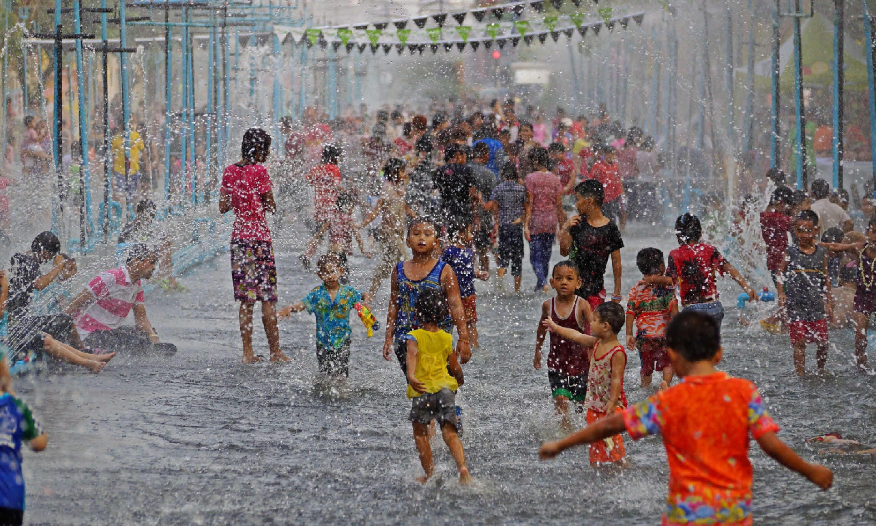 Children and people of Ubon Ratchathani during Songkran (Shutterstock)