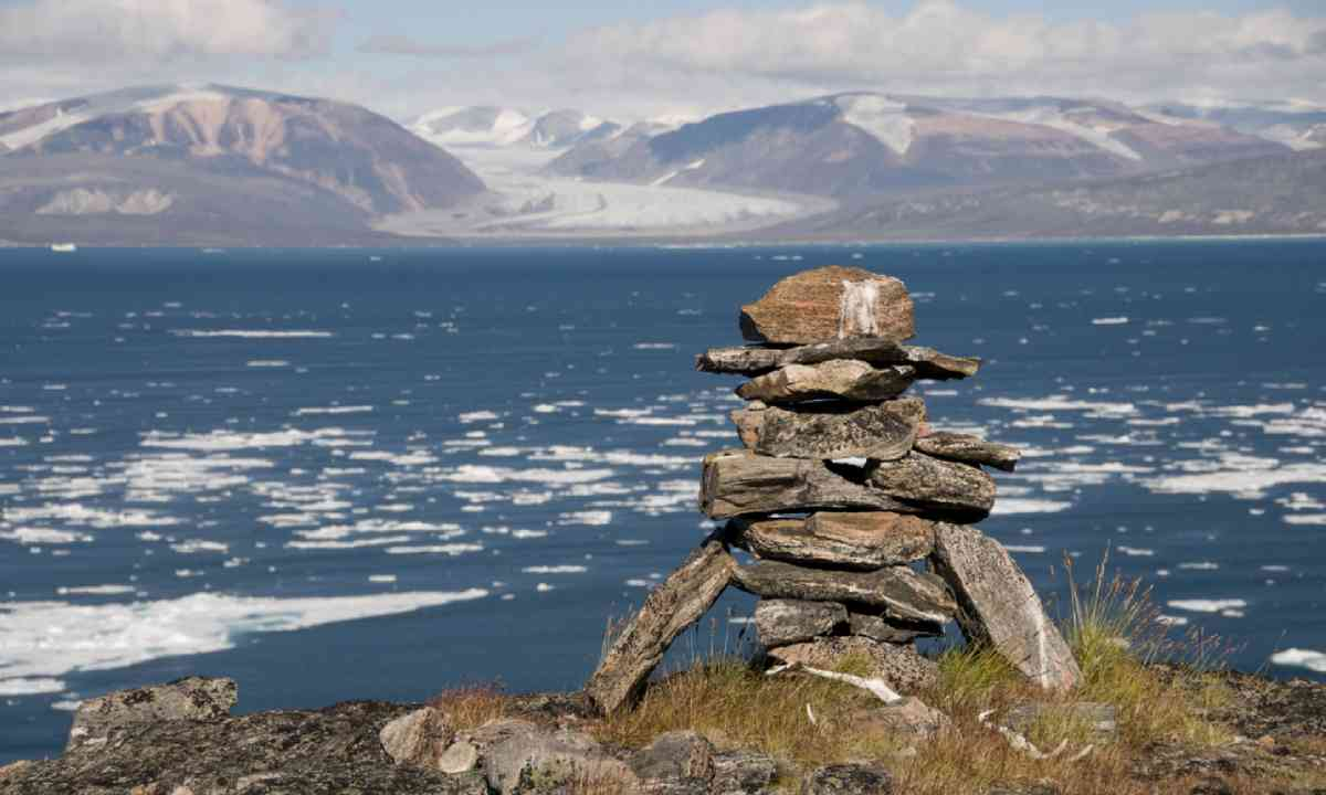 An ancient Inuit inukshuk serves as a landmark for seafarers (Shutterstock)