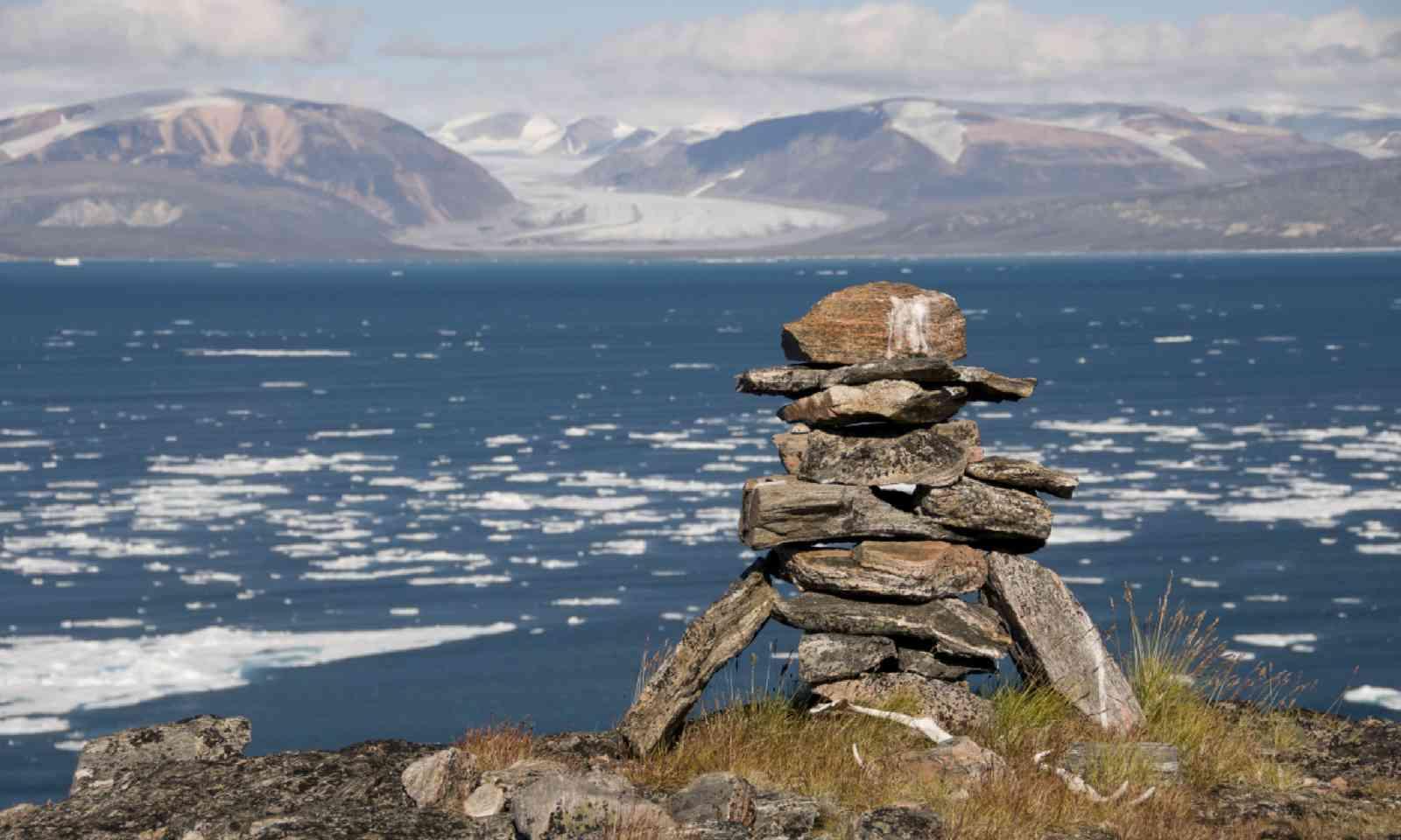 An ancient Inuit inukshuk serves as a landmark for seafarers (Shutterstock)