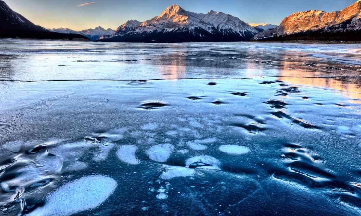 Frozen methane bubbles trapped under Lake Albert (Dreamstime)