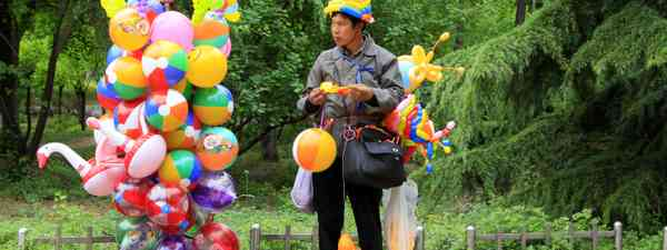 Chinese balloon seller (From Shutterstock.com. See below.)