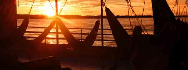 Amazonian sunset from boat hammock (Bobaroundtheworld.com)