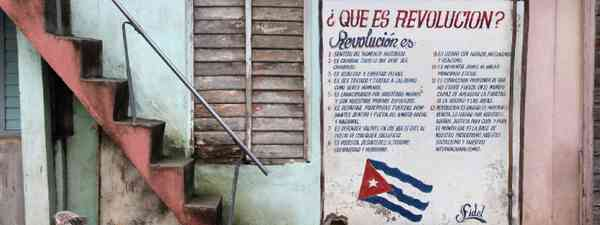 Wall mural celebrates Revolution and Socialism in Baracoa (Shutterstock: see credit below)