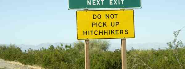 Don't pick up hitchhikers sign (Shutterstock: see credit below)