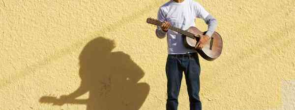 Young guy busking (Shutterstock: see credit below)