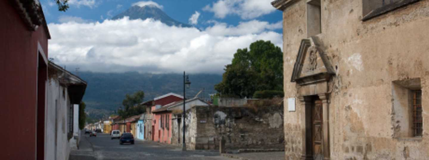 Volcán Agua looms over the streets of Antigua, Guatemala (Flickr: Greg Wills)