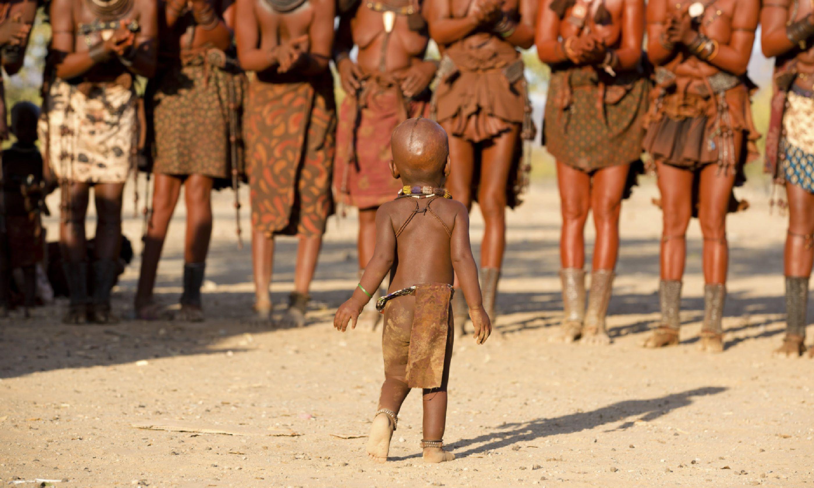 Himba women dancing and clapping (Shutterstock)
