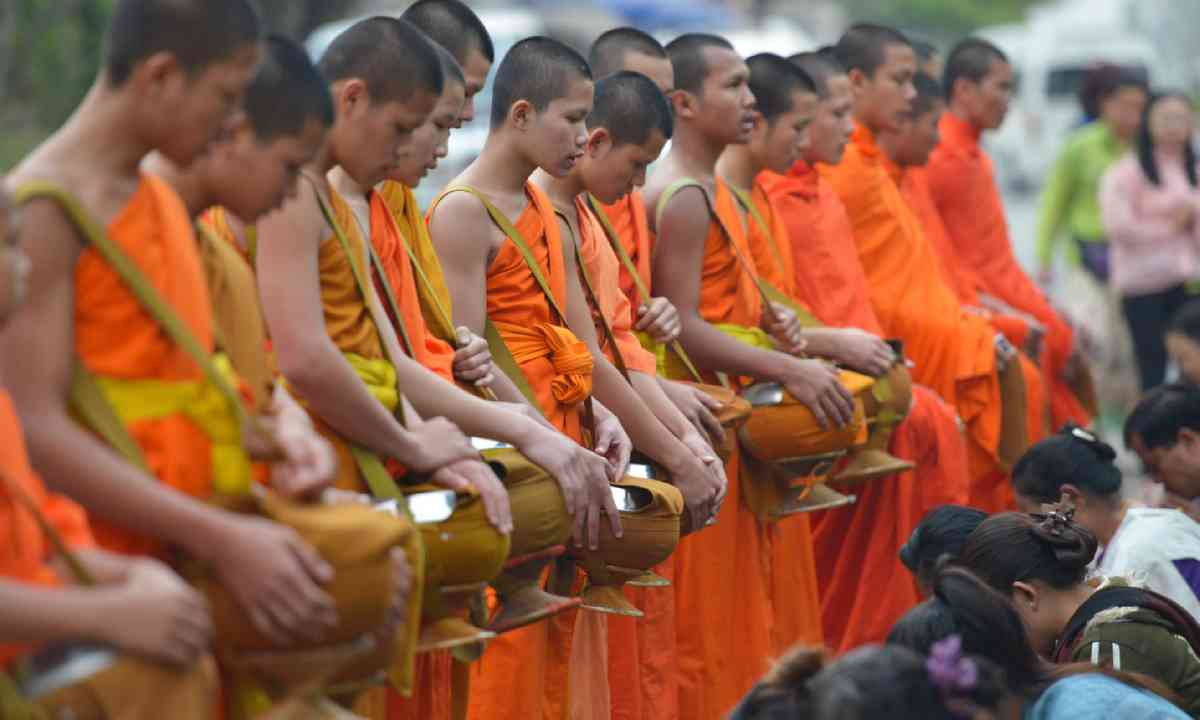 Monks collenting alms, Laos (Shutterstock)