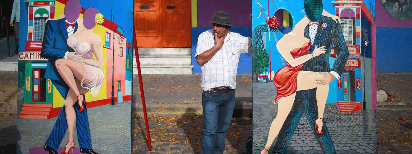 Artist selling colourful paintings in La Boca (Shutterstock: see credit below)