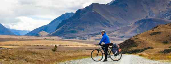A cyclist in New Zealand's Southern Alps (Shutterstock)