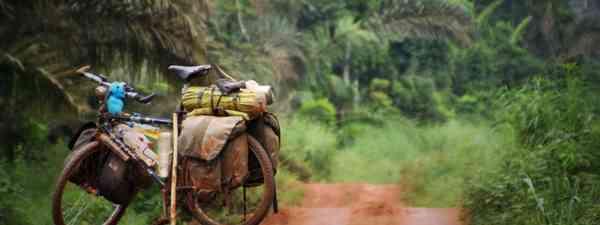 Bike on muddy road, DRC (Charlie Walker)