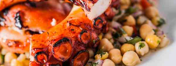 Octopus and chickpeas, served in a Portuguese restaurant (Shutterstock: see credit below)