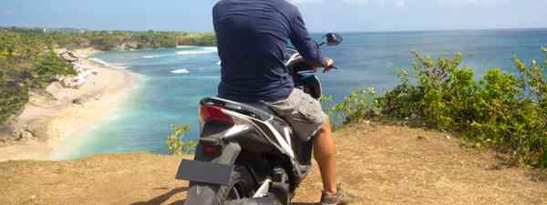On a moped, overlooking a beach (Shutterstock: see main credit below)