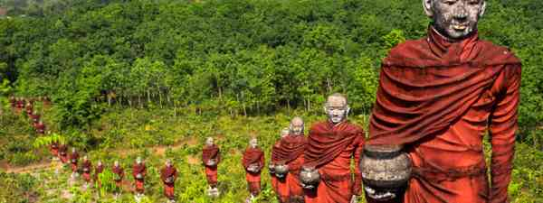 Statues of Buddhist monks collecting alms (Shutterstock: see credit below)