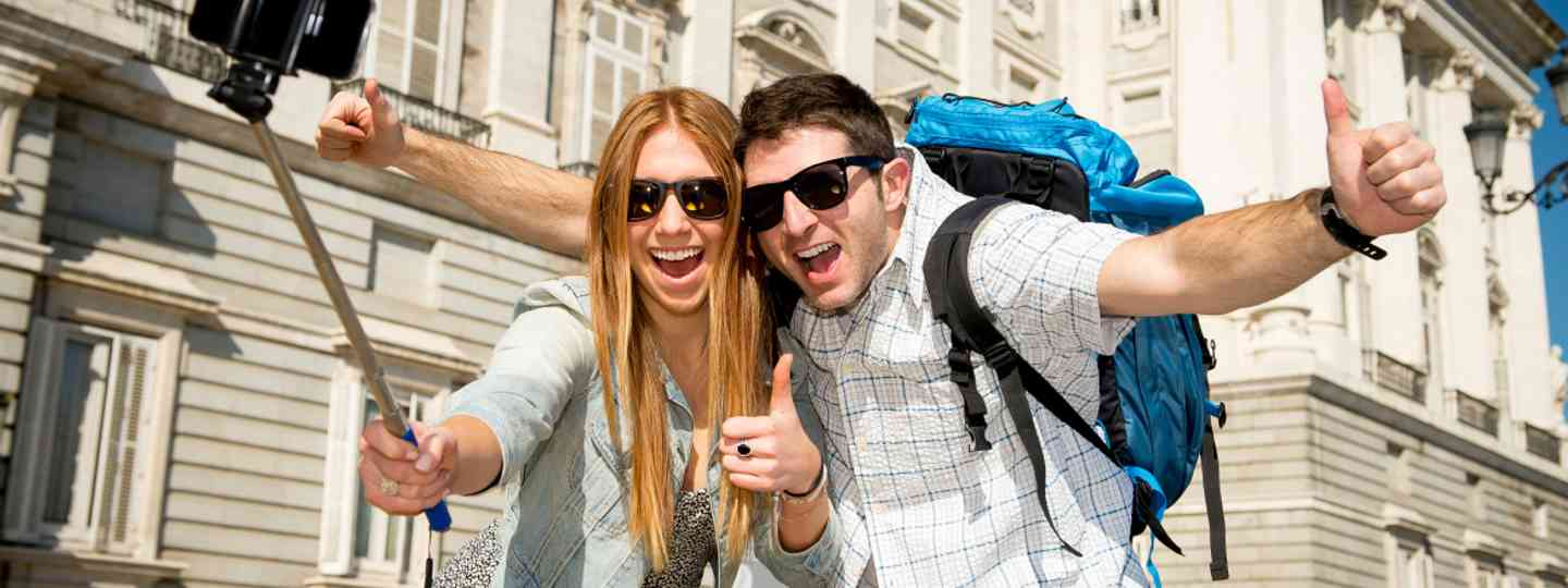 Backpackers using a selfie stick (Shutterstock: see credit below)