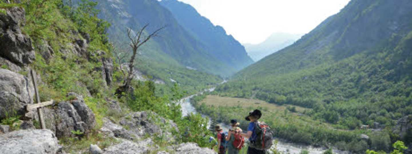 Hikers head along the river valley to the village of Nderlysaj (Phoebe Smith)