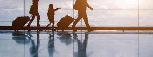Silhouette of family at airport (Shutterstock.com. See main credit below)
