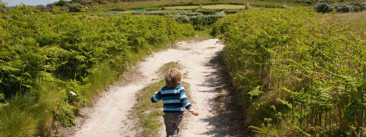 Child running on holiday in England (Shutterstock: see credit below)