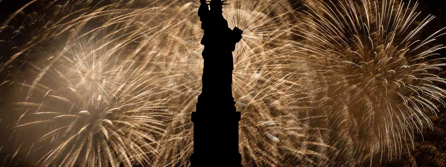 Statue of Liberty under fireworks on Independence Day (Shutterstock.com. See main credit below)