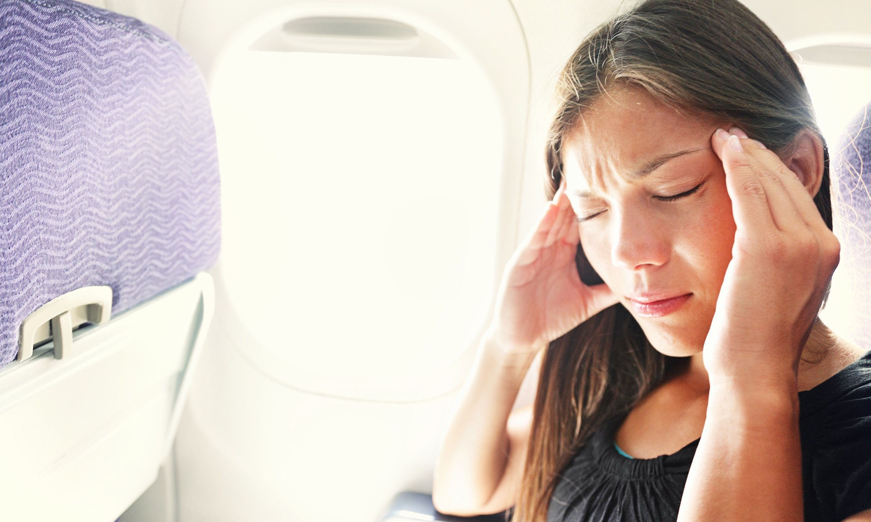 Stressed passenger employing calming techniques (Dreamstime)