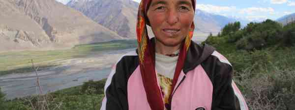 A Pamiri lady outside her house in the Wakhan Corridor (Antonia Bollingbroke-Kent)