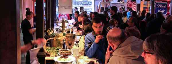 People enjoying food in Mercado San Miguel, Madrid (Shutterstock.com. See main credit below)