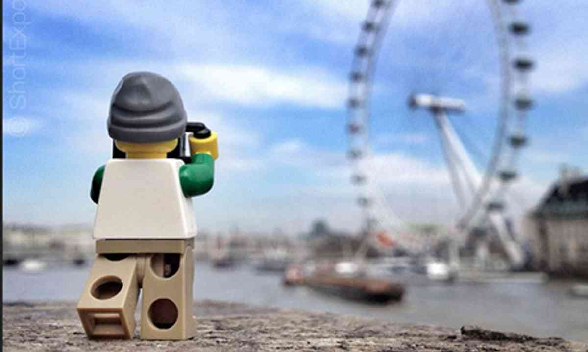 Legoman taking photo of London Eye (Andrew Whyte)