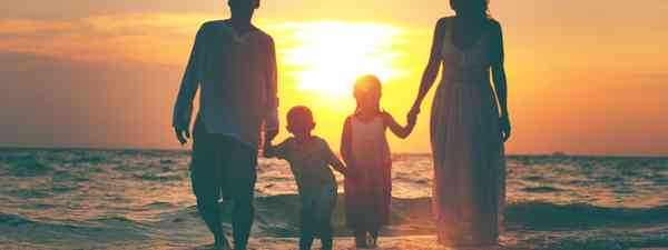 Family on a beach at sunset (Shutterstock.com. See main credit below)