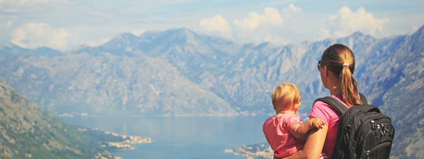 Woman and child  looking across lake (Shutterstock.com. See main credit below)