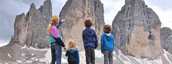 Family contemplating mountain in Italy (Shutterstock.com. See main credit below)