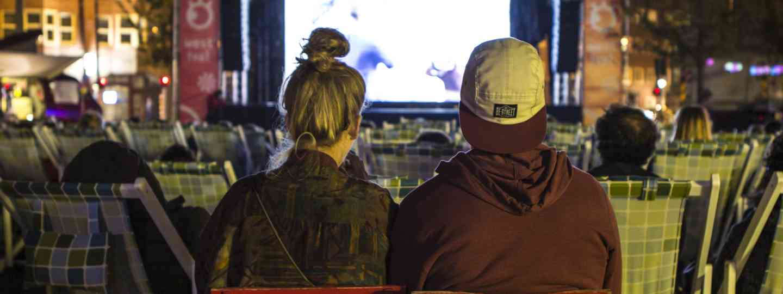 Teens at outdoor cinema in Amsterdam (Shutterstock.com. See main credit below)