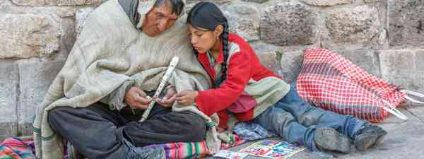 Young girl sharing moment with older relative in Peru (Shutterstock.com. See main credit below)