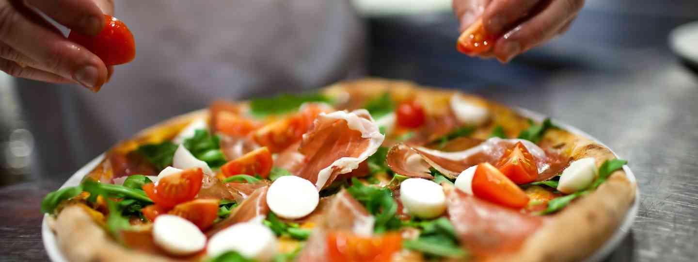 Chef preparing pizza (Shutterstock.com. See main credit below)