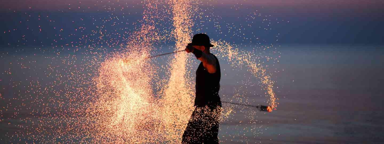 Fire dancer on beach (Shutterstock.com. See main credit below)