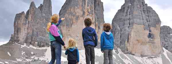 Family discussing the best way around the Dolomites (Shutterstock.com. See main credit below)