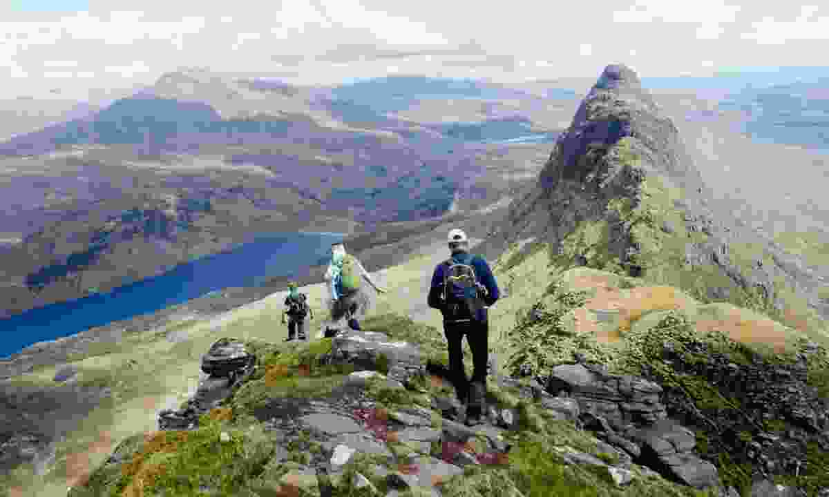 Hikers on Suilven in the Northwest Highlands (Wilderness Scotland)