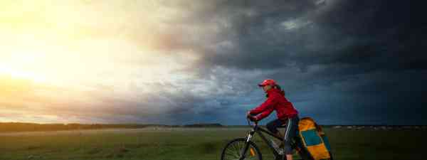 Cycling into a storm (Dreamstime)