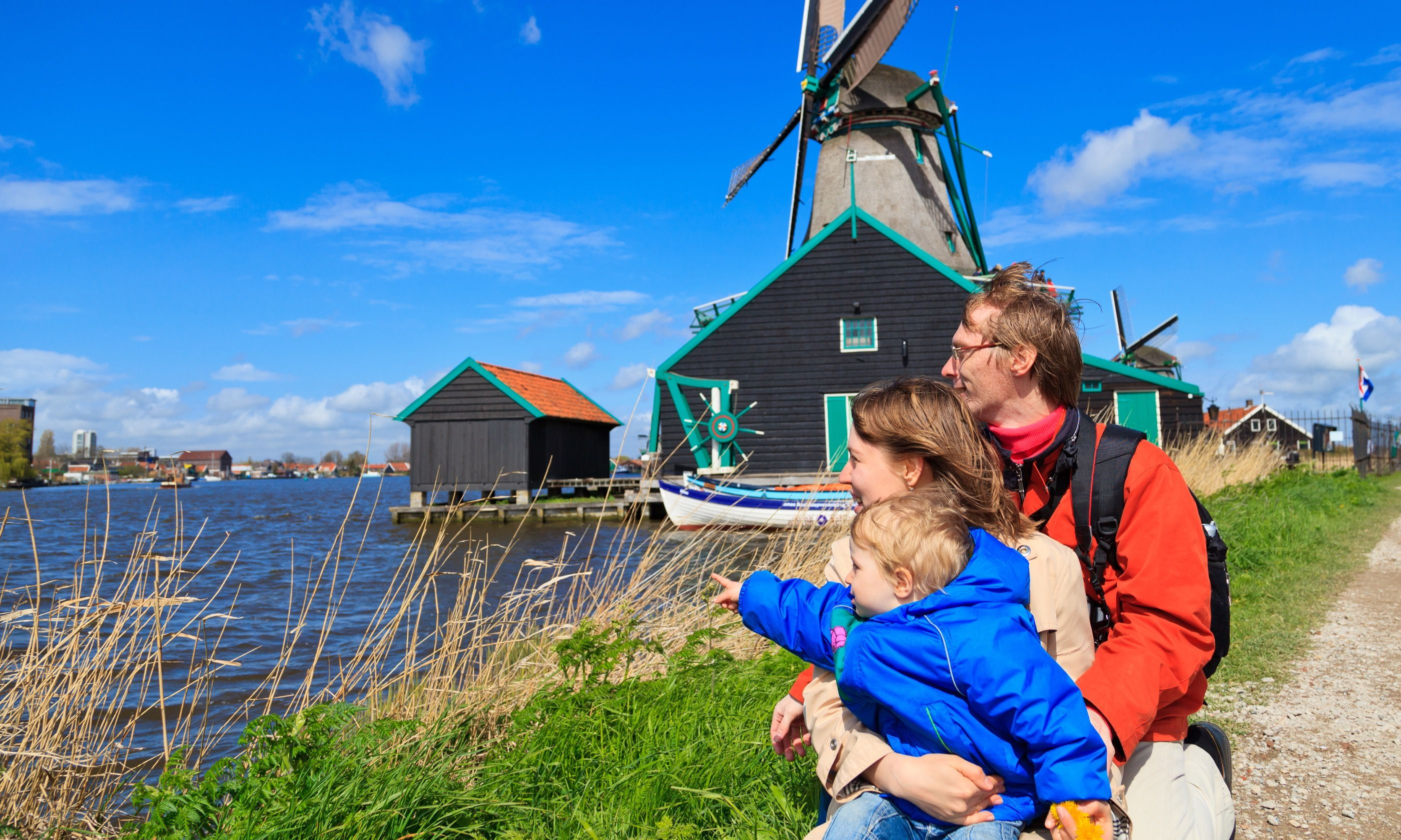 Family checking out windmills in Holland (Dreamstime)