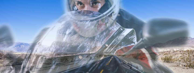 Hallucinating motorcyclist in desert (Dreamstime)