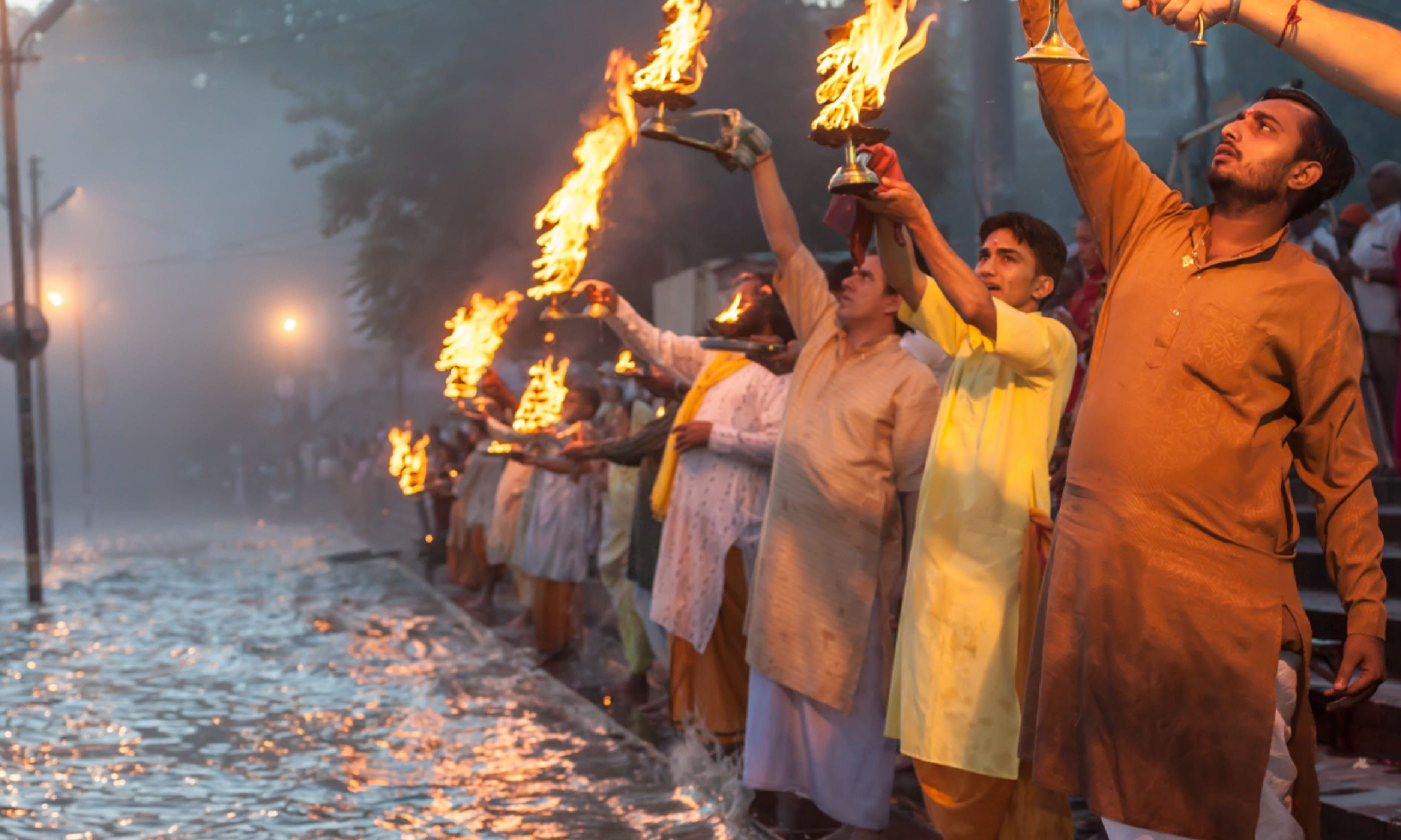 Brahmin priests perform the arati ceremony to the River Ganges (Shutterstock)