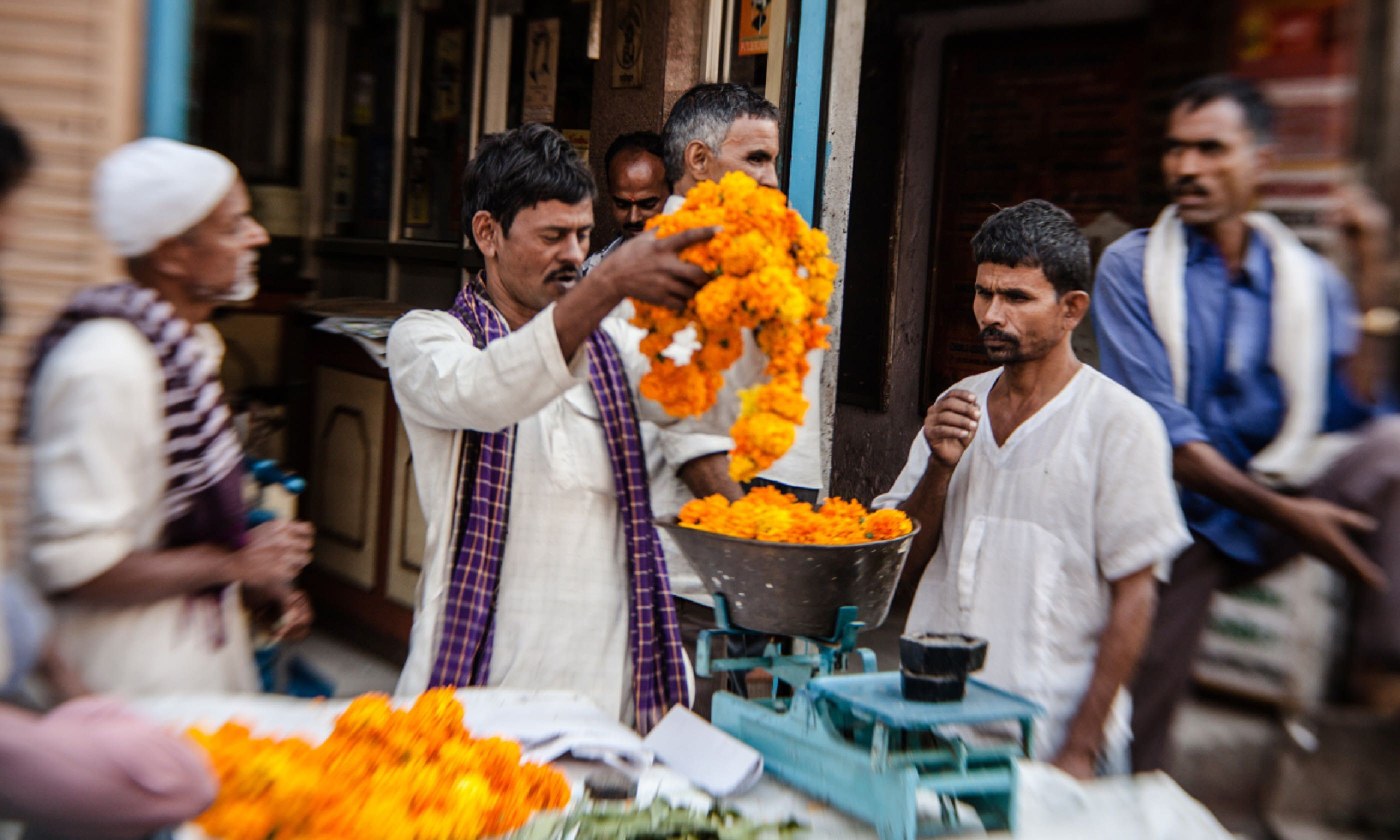 Buying flowers in a Delhi market (Shutterstock)