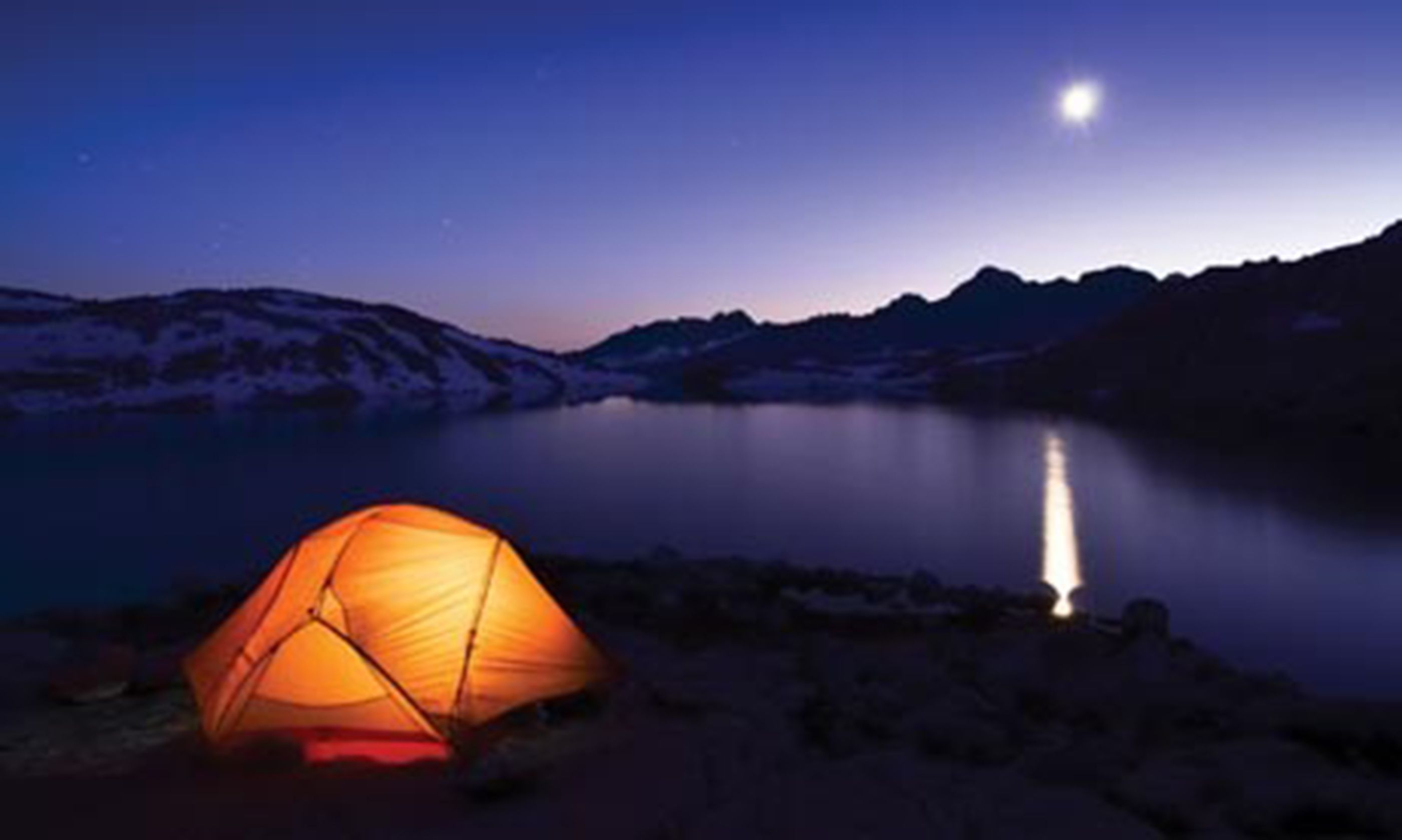 Camping by a lake at night (iStock)