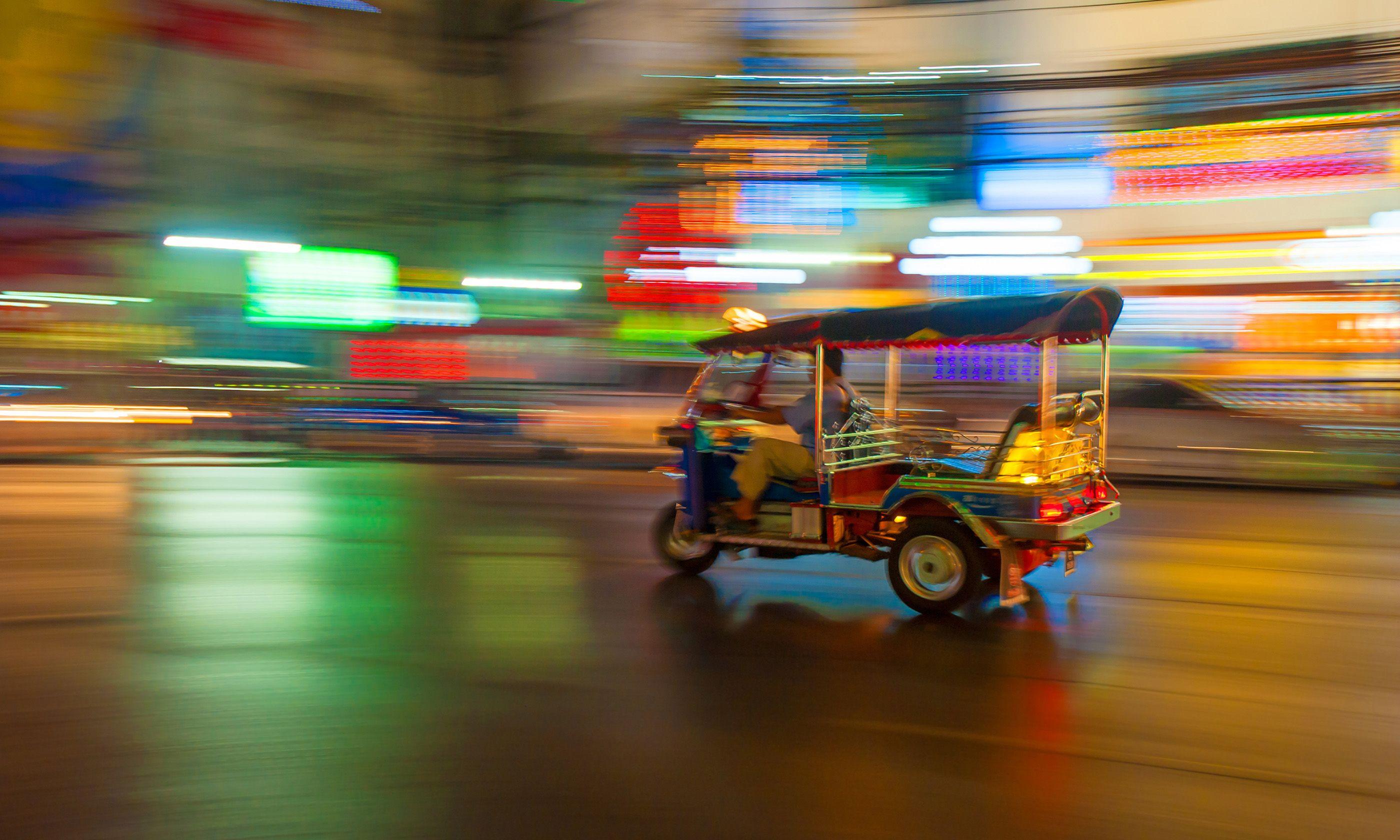 Tuk-tuk in motion (Shutterstock.com)