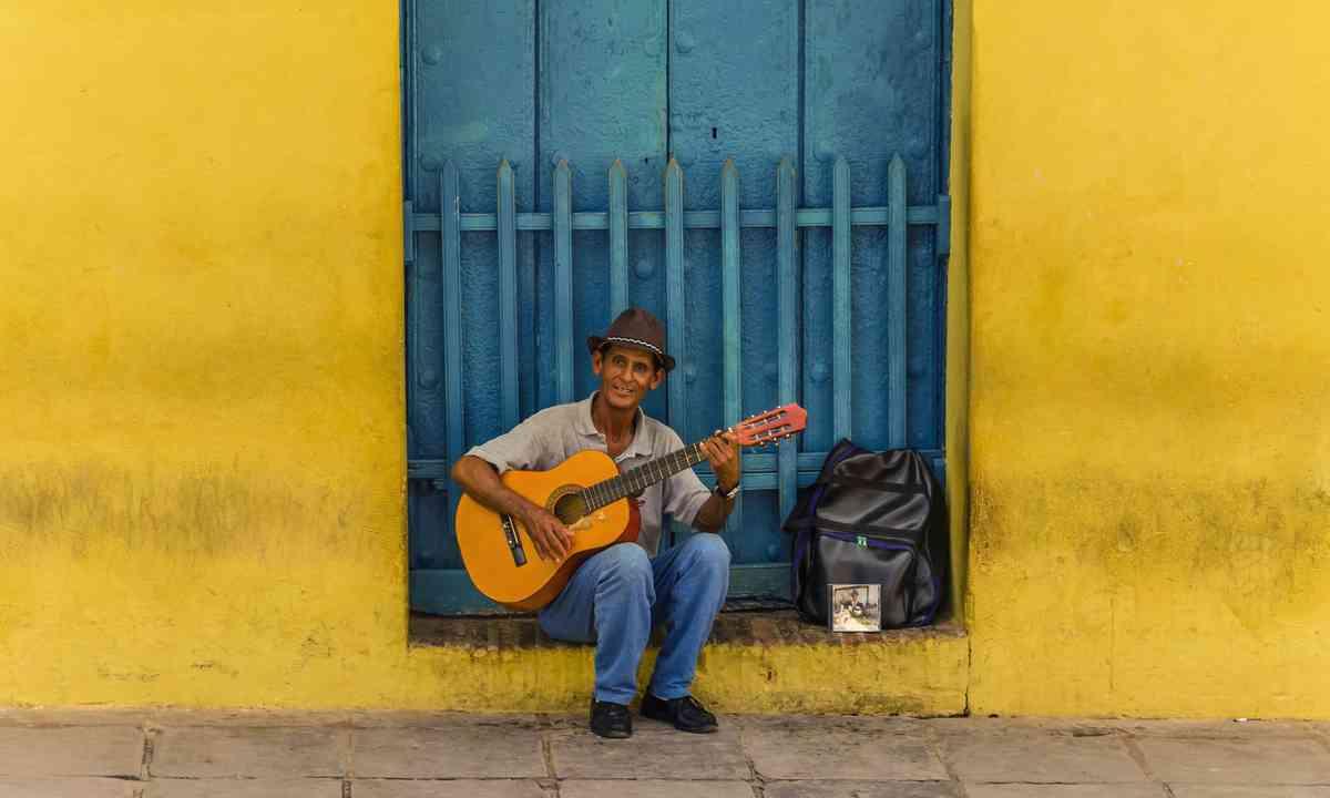 Man playing guitar in Trinidad, Cuba. From Shutterstock.com