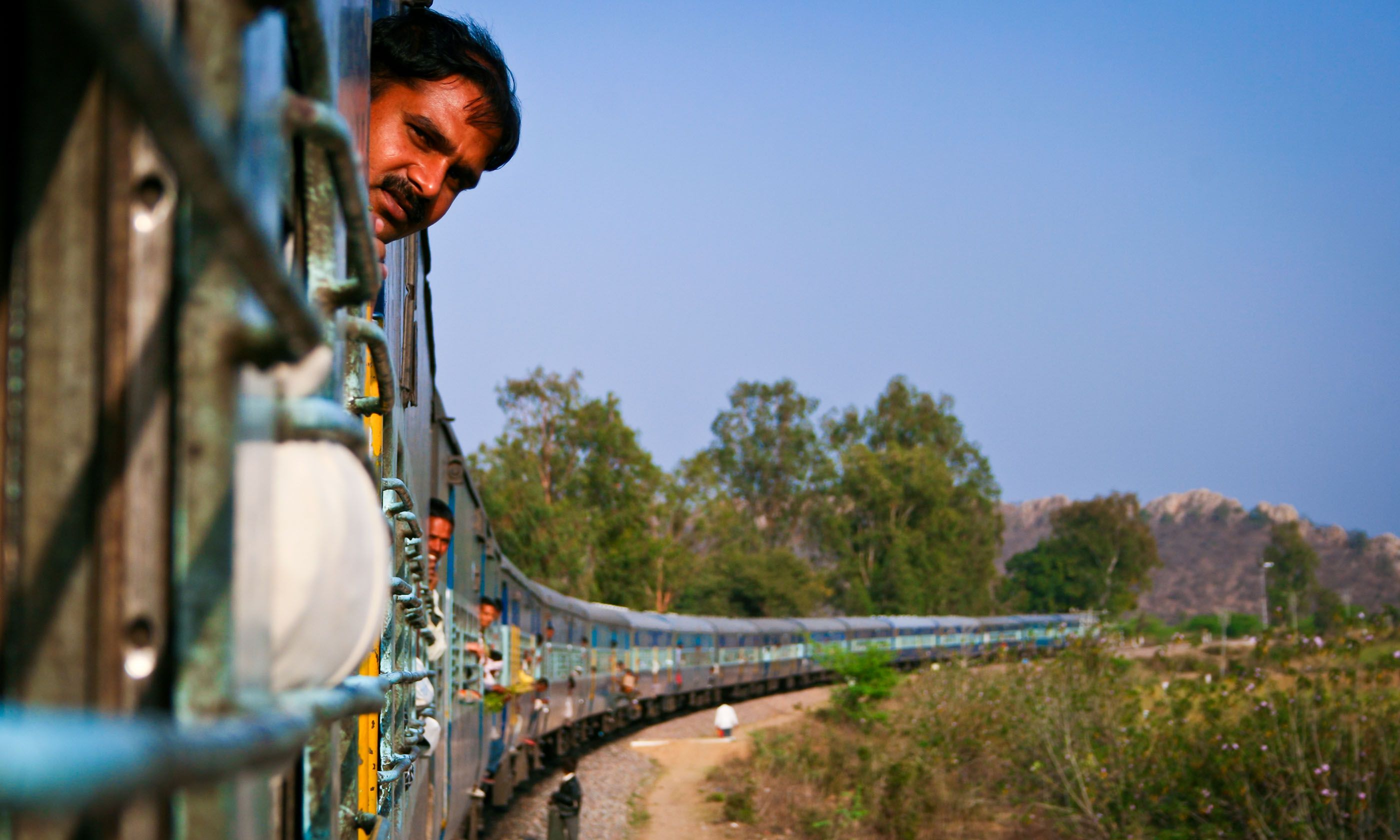 Man riding train in India (Shutterstock.com)