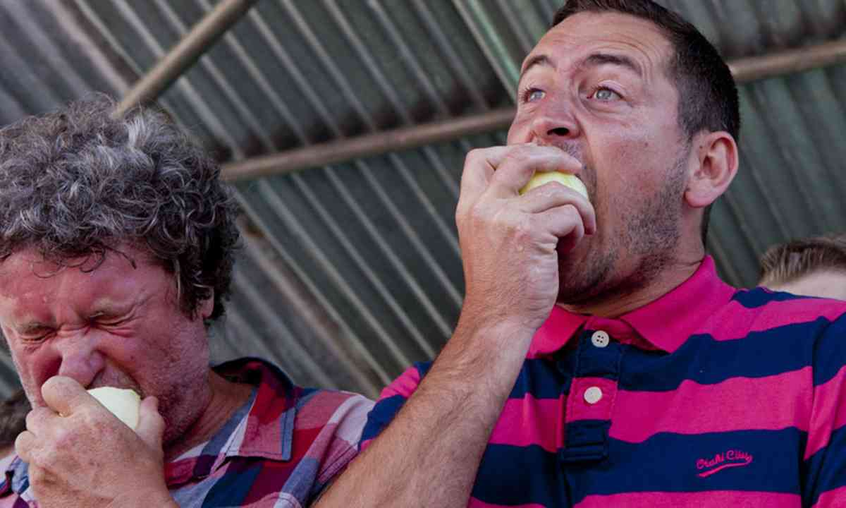 Eating onions at the Newent Onion Eating Fayre (Used with permission from Charlotte Offord)