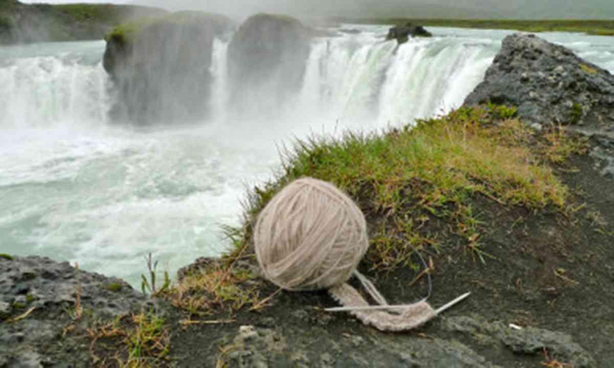 Knitting beside a waterfall (InspiredByIceland.com)